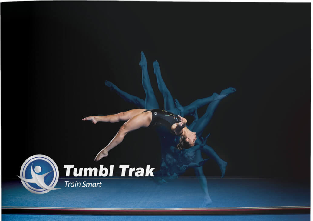 cover features a gymnastic practicing on a floor beam